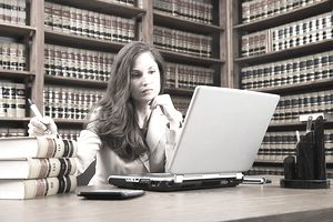Female lawyer looking at laptop
