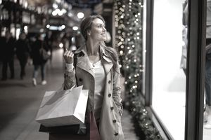 woman looking in store window