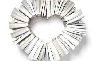 paperback books arranged in heart shape
