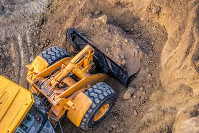 High Angle View Of Bulldozer Moving Dirt