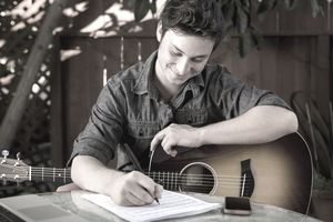 Song writer with guitar