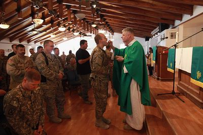 Military chaplains at church service with U.S. Soldiers