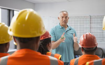 Man discussing safety with construction workers