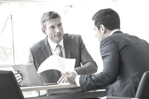 Businessmen negotiating and accepting a counter offer