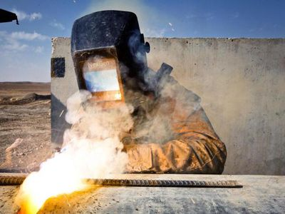 Lance Cpl. Tyler Sletterink, a metal worker with Support Company, 9th Engineer Support Battalion, uses a welding torch