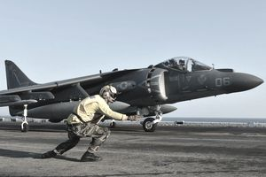 "Releasing the Nightmares Aviation Boatswains Mate 3rd Class Cesar Salinas launches an AV-8B Harrier jet aircraft, assigned to the ""Nightmares"" of Marine Attack Squadron (VMA) 513, from the flight deck aboard the forward-deployed amphibious assault ship USS Bonhomme Richard (LHD 6), March 9, 2013. The Bonhomme Richard Amphibious Ready Group, currently on deployment in the U.S. 7th Fleet area of operations, is conducting amphibious integration training (AIT) and is scheduled to participate in certification exercise (CERTEX) upon completion of AIT."