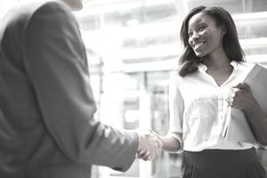 business people shaking hands before an interview