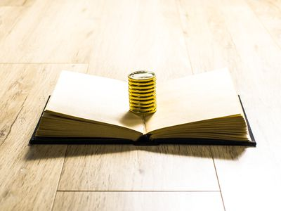 stacked coins on a book