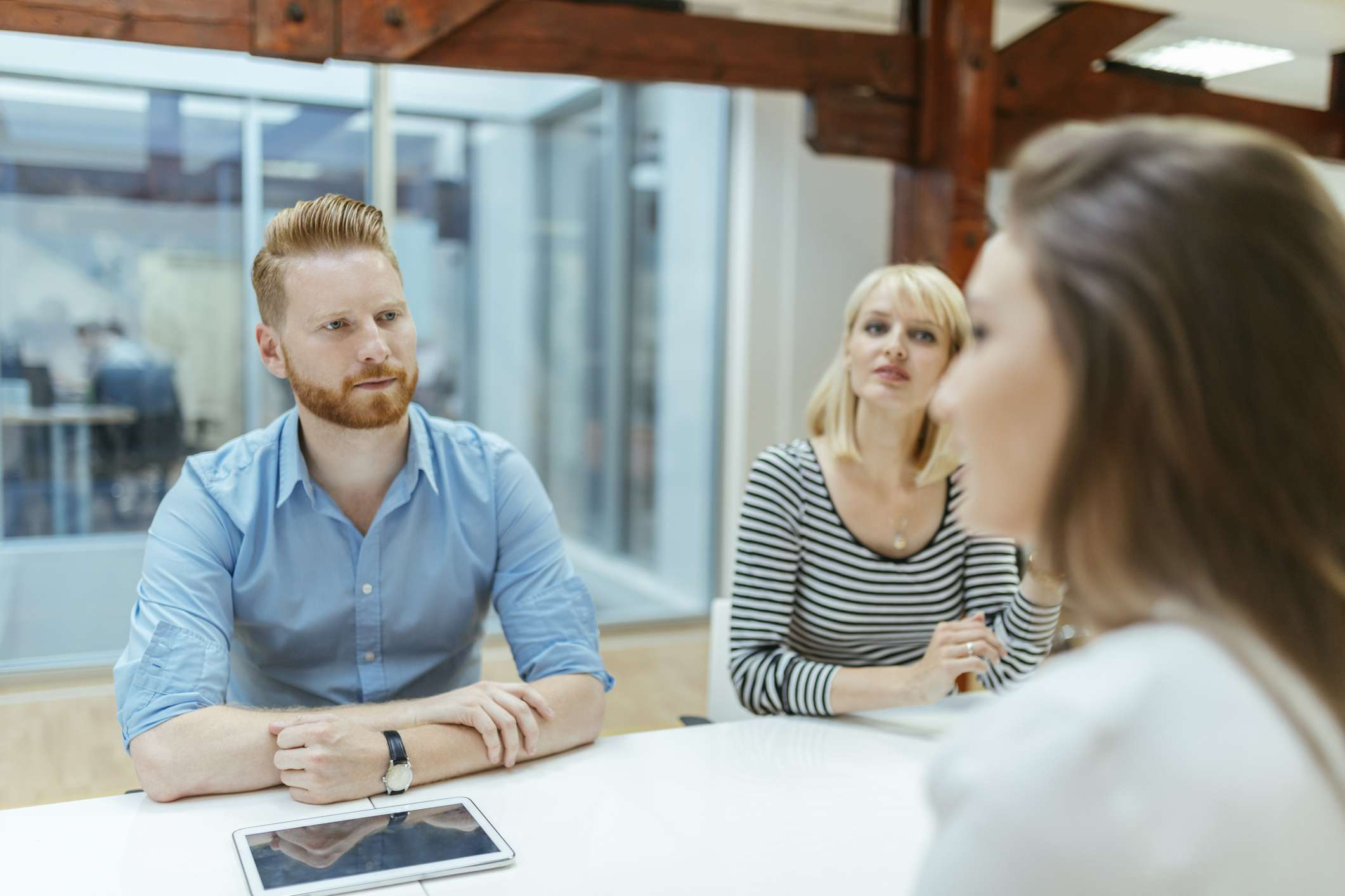male and female employee interviewing a job candidate