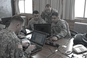 Electromagnetic Spectrum Advisor looking over data with Army personnel