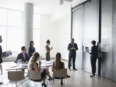 Business people brainstorming in conference room meeting