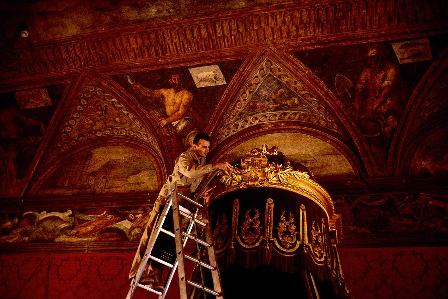 Worker Cleaning the Throne in the Palais du Prince.
