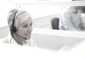 Mature female customer service representative