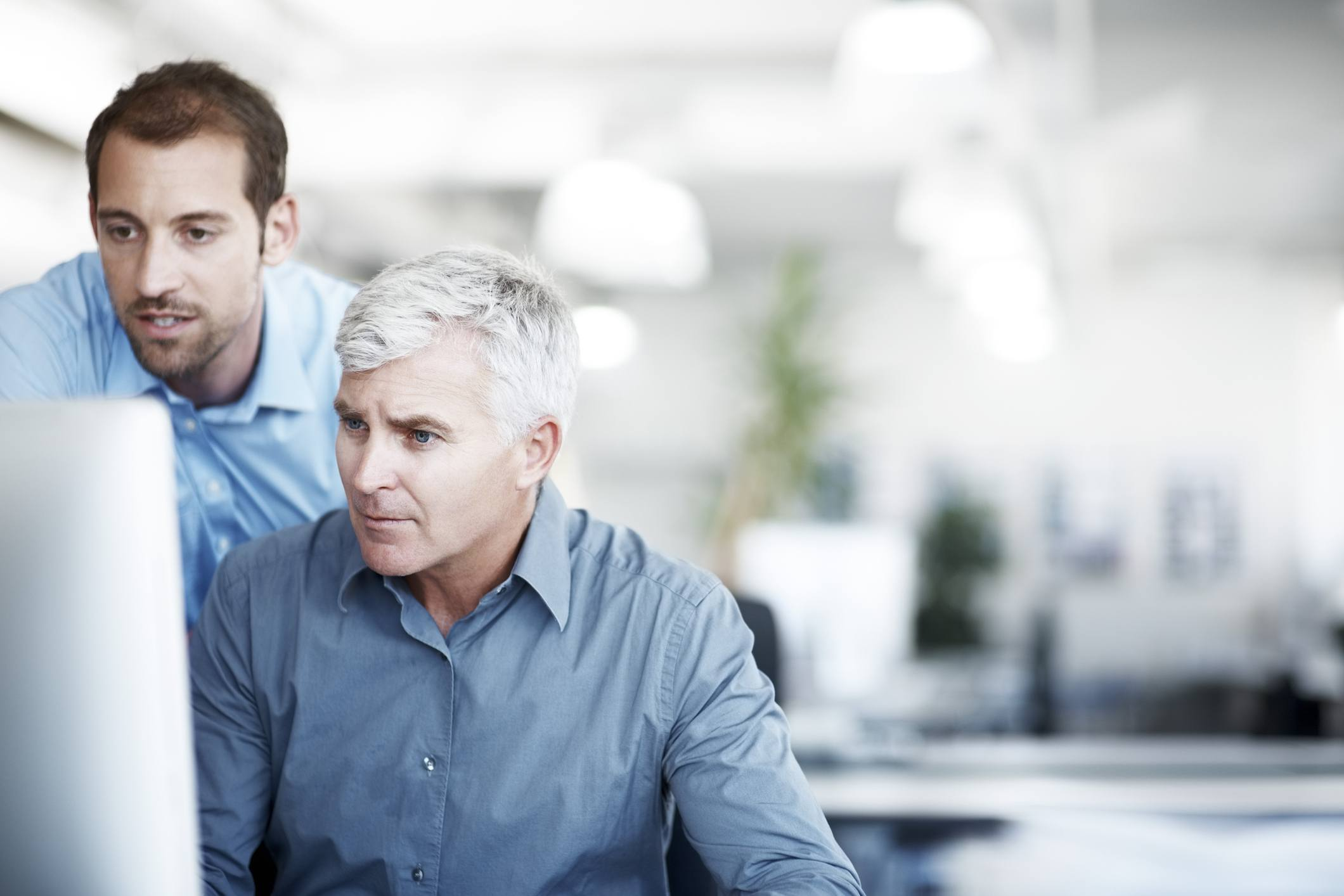 Two men working on computer