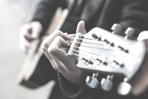 Close up of a musician playing a guitar