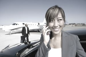 Woman at airport on cell phone
