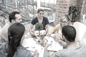 Team of coworkers meeting around table