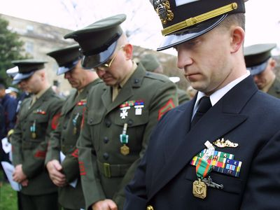 Men wearing Navy and Marine Corps Achievement Medal