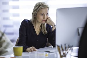 Serious businesswoman working at computer in office