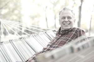 Retired male government employee lounging in a hammock