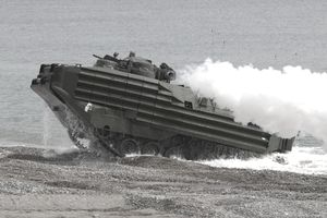 U.S. Marines Amphibious Assault Vehicle (AAV) coming ashore on a beach