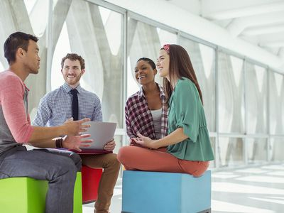Group of happy, engaged co-workers talking