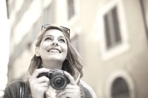 Woman traveling and holding camera