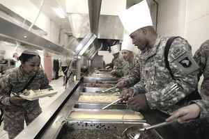 Army chef serving other soldiers