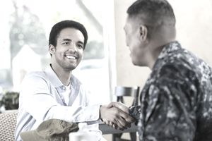 New military recruit shakes hands with a recruiter