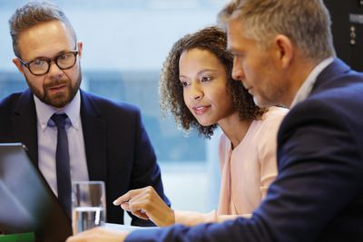 Financial advisior having a meeting with couple