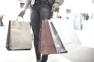A picture of a woman with shopping bags