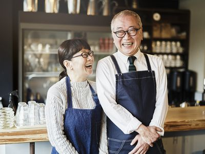 Senior couple cafe owners working in cafe together