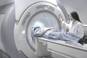 A woman conducting an MRI