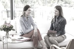 Two woman in a relaxed setting having a semi-structured interview.