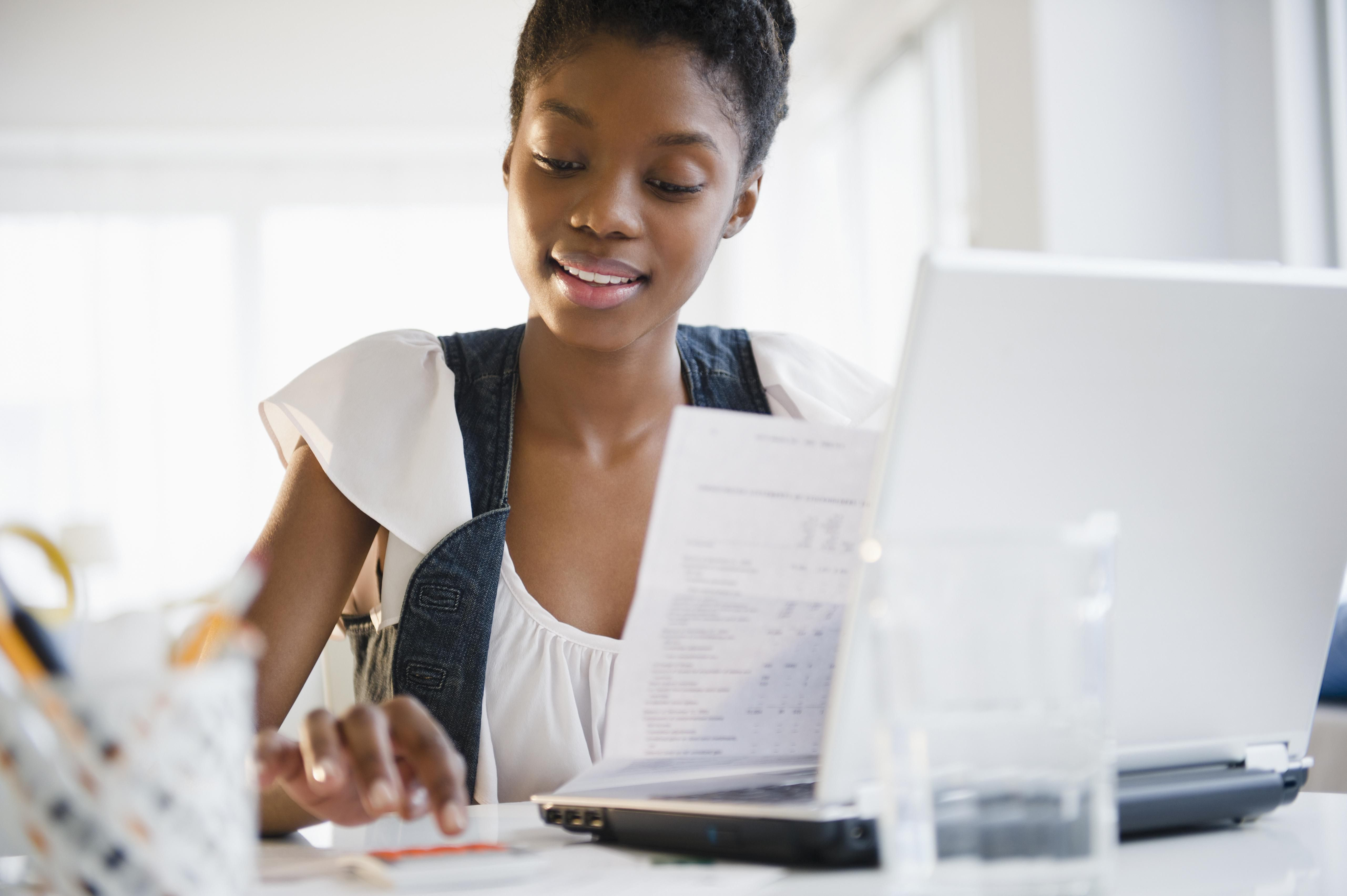 Woman sitting in front of computer preparing taxes