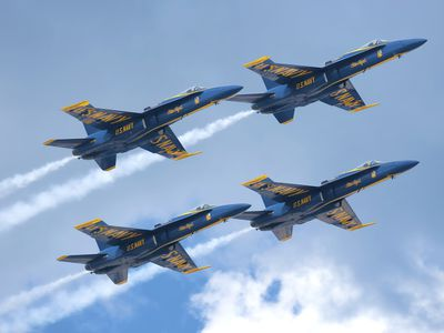 The Blue Angels aircrew flying in formation over Pensacola Beach, Florida.