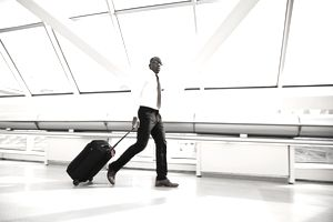 Man with luggage walking through airport