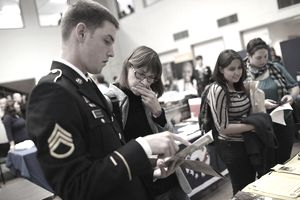 KENTFIELD, CA - OCTOBER 26: A job seeker meets with a recruiter from the U.S. Army National Guard during the College of Marin's annual fall job fair on October 26, 2011 in Kentfield, California. The one-day job fair had recruiters from over 20 different organizations.