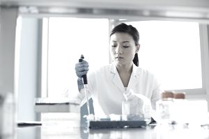 Scientist using pipette in research laboratory