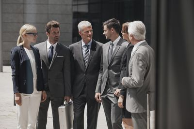 Group of business people dressed in formal business attire.