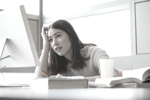 College grad looking at job listings on a computer