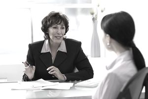 Mature businesswoman talking to colleague