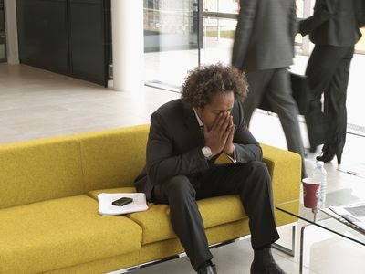 Stressed, young businessman waiting for interview