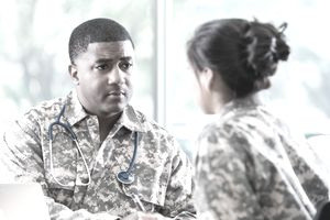 Military physician discussing results of an HPV test with a young recruit.