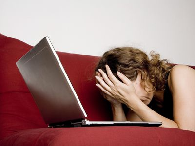 woman upset with laptop