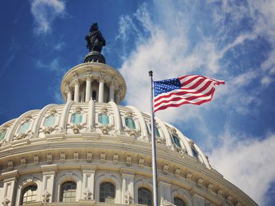 US Capital dome exterior with American flag