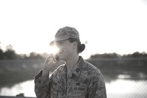 Female soldier talking on smartphone