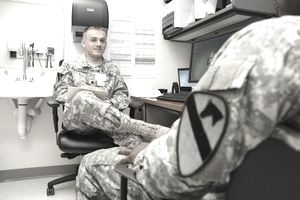 Army Mental Health Specialist talking with a patient.