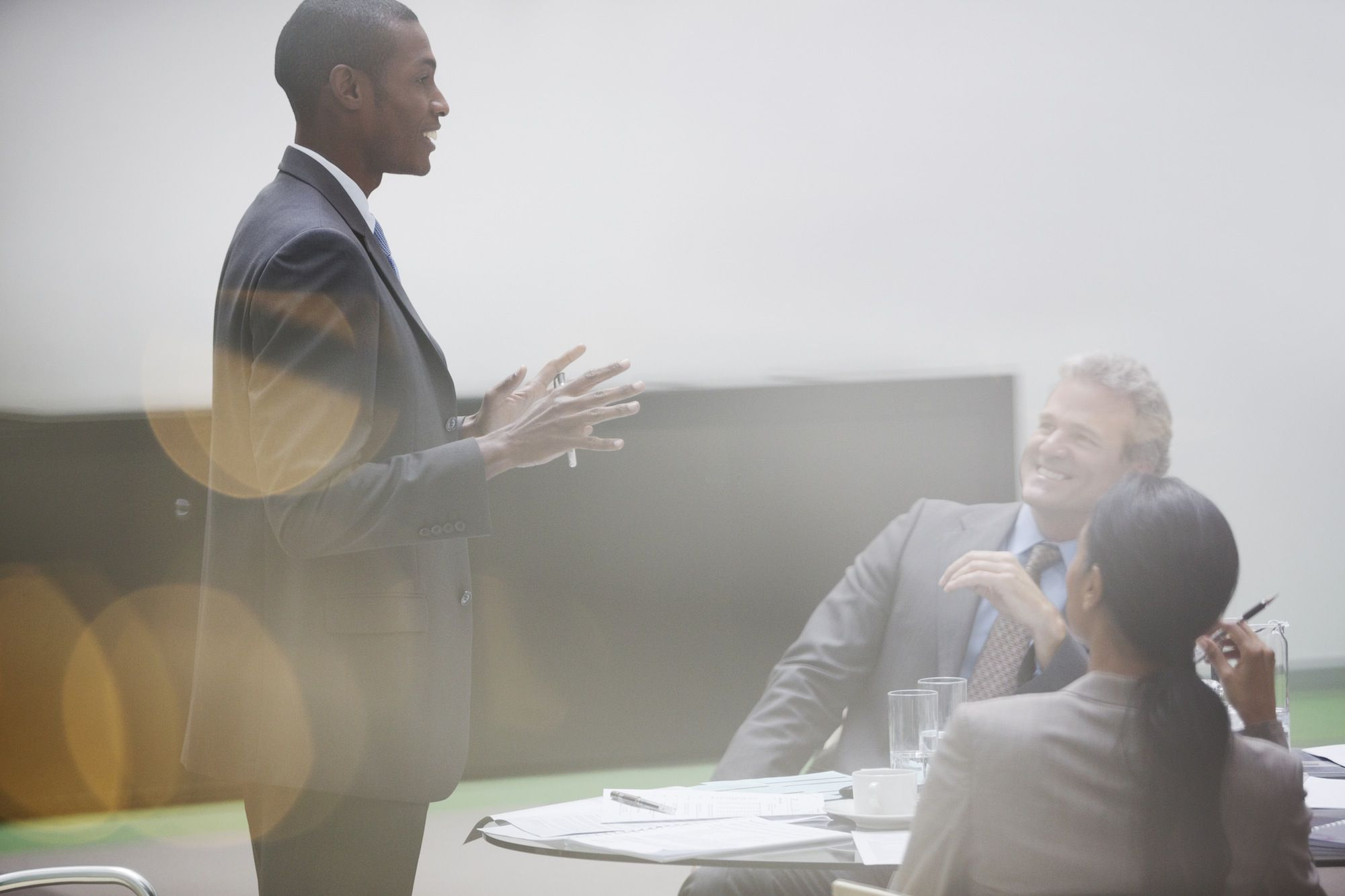 Gesturing businessman leading meeting in conference room