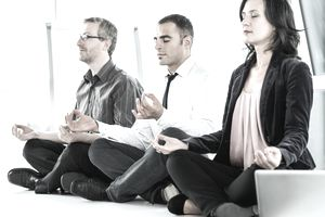 Business professionals meditating